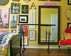 DIY ballet barre and mirror via Laughing Abi - I also like the wall collage and vibrance of the room!