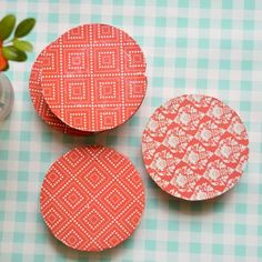 These pretty coasters are made of scrap wood and scrap book paper.