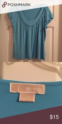Pretty MK ruffled Blue Top Pretty blue top with ruffle neck and sleeves. No tags but never been worn. Michael Kors Tops Blouses