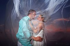 Sunset sky, long wedding veil, bride and groom portraits, wedding art, wedding inspiration, wedding photography, Cancun, Mexico