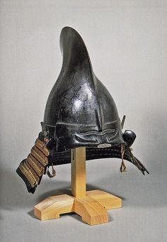 Kabuto helmet, Momoyama period. Kabuto (兜, 冑) is a type of helmet first used by ancient Japanese warriors, and in later periods, they became an important part of the traditional Japanese armour worn by the samurai class and their retainers in feudal Japan. The Azuchi–Momoyama period (安土桃山時代 Azuchi-Momoyama jidai) is the final phase of the Sengoku period (戦国時代 Sengoku jidai) in Japan. These years of political unification led to the establishment of the Tokugawa shogunate. c.1573-1600