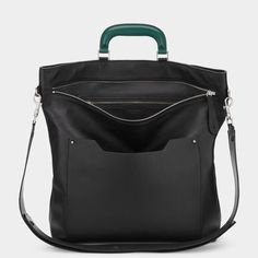 The Orsett is a soft day bag inspired by an artist's satchel. The leather luggage handle adds a luxurious finish, while the detachable strap enables it to be worn folded over the shoulder. We recommend wearing it soft and slouchy with the zip open. Item number: 5050925937887