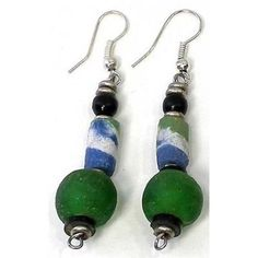 Paul makes his jewelry in the Westlands Market where he has a workshop not much bigger than a telephone box. He uses beads from all over Africa to create his jewelry designs. These earrings feature vi