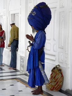 "Sikh Prayer - ""In Sikhism, Kesh (sometimes Kes) is the practice of allowing one's hair to grow naturally as a symbol of respect for the perfection of God's creation. The hair is combed twice daily with a Kanga (small comb), and tied into a simple knot known as a Joora or Rishi knot . . . and covered by a turban.""  ~ Wikipedia"