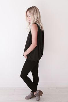 """• Black crop top tank • Comes in S, M, L. Aspyn is 5' 4"""" and wearing a size small • 70% MODAL 30% POLYESTER"""