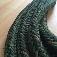 This is a 22 long mecate. 12 strands of paracord braided around a nylon cord core gives a little more than a 1/2 rein. I believe that mecates braided this way fall a little nicer than ones braided over a strand of paracord. If you arent familiar with mecate reins, please look in to them a little bit. These are great for trail riders or working horseman because a nice 12 lead is integrated right in to the setup!  To be used with slobber straps and a snaffle mouthpiece.  Please feel free t...