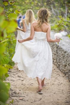 The braidsmaids wore flipflops and white lace dresses