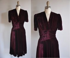 1930s art deco velvet dress. V-cut in the front. Theatre draping around the waist line. Gathered bust area. Small around edge shoulder pads. Velvet belt buckle in the back. Side metal zipper for closure.