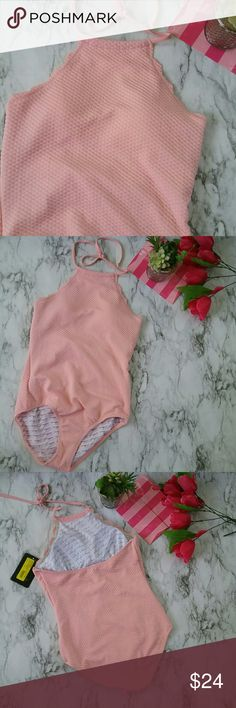 Marilyn Monroe Pretty Pink Scalloped Swim Suit NEW This is a Marilyn Monroe swimwear Style color pretty pink one-piece swimsuit at has a scalloped edge of the neckline. It is new with tags. The MSRP is $80. Marilyn Monroe Swim One Pieces