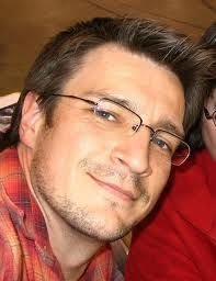 Nathan Fillion aka Mal Reynolds with glasses. This is why it's in the category, nerdgasms :)