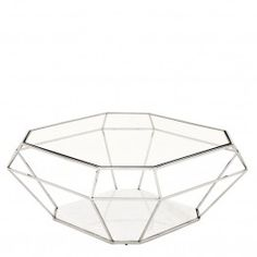 Our Eichholtz Asscher Nickel coffee table is a wonderful piece that is sure to add a palatial feel to your living room. It has a beautiful base made from marble and a gorgeous nickel finished frame supporting a clear glass top making it both elegant and f