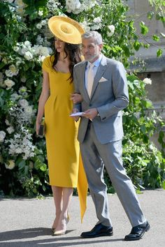 Meghan and Harry's Royal Wedding guests: Amal Clooney in a yellow midi dress and hat