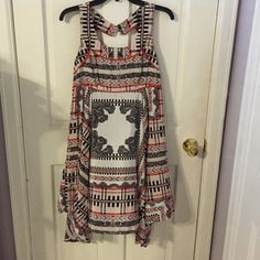 Jessica Simpson Silky Patterned Dress NWOT Worn once, essentially brand new, just sat in my closet. Jessica Simpson Authentic dress. Size large, super cute pattern and flowy/silky material. Smoke free home, fast shipping Jessica Simpson Dresses