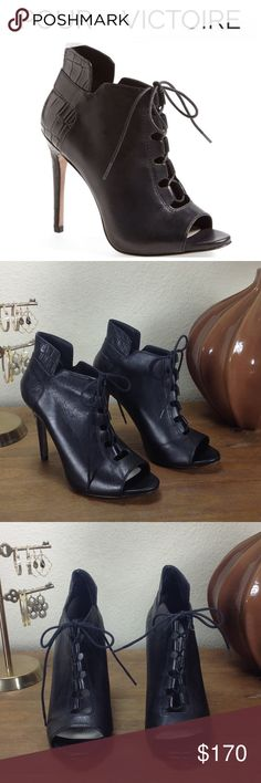 Pour La Victoire Vionne Black Leather Ankle Boot Stunning black leather peep toe Lace-up ankle boot with crocodile embossed leather trim. In excellent condition with no visible scratches or marks. Does have a small blemish on the underside of the heel that is very difficult to see (see pics) and can't be seen when wearing. Thanks for your interest!  Please checkout the rest of my closet. Pour La Victoire Shoes Ankle Boots & Booties