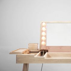 Wooden vanity table with folding mirror and make-up lights - here shown in solid waxed oak and rose gold copper.