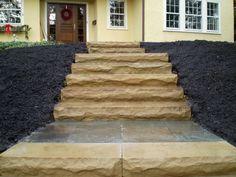 Natural sandstone steps with bluestone landings.