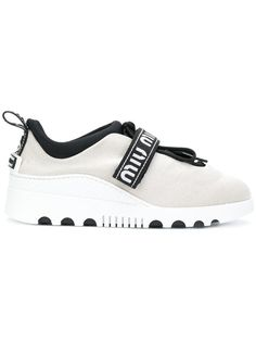 Shop Miu Miu touch strap sneakers.