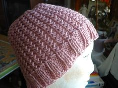 Crossed Comfort Hat....go down further on the page for the link to the designer's pattern.