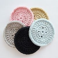 Crocheted vintage coasters. They look like huge buttons.