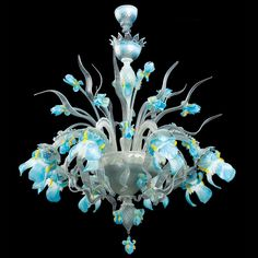 """""""Iris blu"""" Murano glass chandelier, hand made by authentic Masters glassblowers from Murano.Made on demand. The dimensions and the colors can be customised to individual specifications.Vacuum-packing, worldwide shipping and total insurance coverage. Murano Chandelier, Flower Chandelier, Luxury Chandelier, Chandelier Lighting, Flower Lamp, Antique Chandelier, Lustre Murano, Crystal Glassware, Bleu Turquoise"""