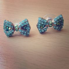 Teal bow earrings Teal bow earrings. Super cute with any outfit. Jewelry Earrings