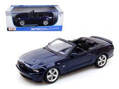 2010 Ford Mustang GT Convertible Dark Blue 1/18 Diecast Model Car by Maisto - Brand new 1:18 scale diecast car model of 2010 Ford Mustang GT Convertible Dark Blue die cast car by Maisto. Brand new box. Rubber tires. Has opening hood, doors and trunk. Made of diecast with some plastic parts. Detailed interior, exterior, engine compartment. Dimensions approximately L-10, W-4, H-3.5 inches. Please note that manufacturer may change packing box at anytime. Product will stay exactly the…