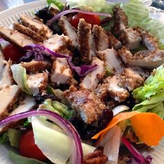Pecan crusted chicken over a bed of mixed greens, shredded carrots, cherry tomatoes, red onions, dried cherries, red onions and pecan slivers