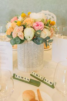 vintage floral centerpiece with scrabble place setting #placesetting #scrabble #weddingchicks http://www.weddingchicks.com/2014/01/22/lake-como-italian-wedding/