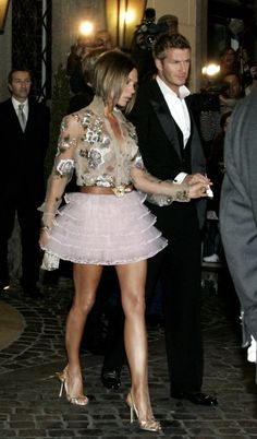 Nowadays, VB just isn't as…ahem…experimental with fashion as she used to be. You wouldn't see her wearing a floral, sequined, sheer shirt with a tutu in 2015. | Friendly Reminder That Victoria Beckham Used To Dress Like This In The '00s