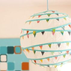 I adore this - http://party.tipjunkie.com/pennant-garland-paper-lantern-diy-party-decor/