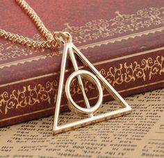 Deathly Hollows Limited Necklace  Grab yours here --> https://shopinsider.biz/products/harry-potter-deathly-hallows-charms-necklace