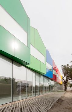 Ábaton styles children's dormitory at Esther Koplowitz Foundation as row of colourful houses.
