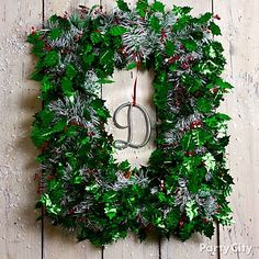 Who says a wreath has to be round? Create a squared-off DIY wreath in no time by wrapping pretty foil garland around a frame and adding a monogram letter to complete the picture. Click for more DIY Christmas wreath ideas!