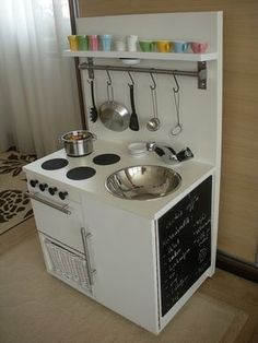 love this diy play-kitchen. especially the charcoal paint on the side!