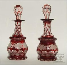 Sandwich Ruby Stained Cologne Bottles - Clear Blown Molded Glass With Ruby Stain - Sandwich, Massachusetts  c.1880-1887