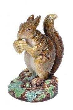 A George Jones Majolica Model Of A Squirrel Eating
