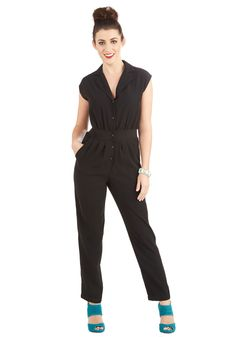 Caught Your Eye Jumpsuit. If the classic silhouette, urban feel, and sexy black tone of this collared jumpsuit put a sparkle in your eye, you certainly arent alone. #black #modcloth