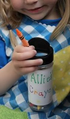 TRAVEL CRAYON HOLDER - parmesan cheese container fits in their carseat cup holders and the name on it is perfect! :)
