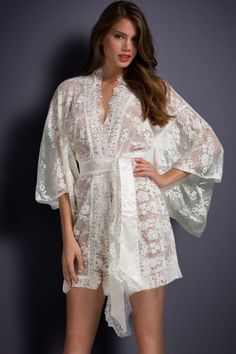 Matinee Kimono by Agent Provocateur Breathtaking French lace kimono in an opulent floral design. Loose kimono sleeves, a satin tie belt and beautiful lace edging add a touch of sheer luxury to your nightwear repertoire. Wedding Night Lingerie, Bridal Lingerie, Luxury Lingerie, Women Lingerie, Sexy Lingerie, Seductive Lingerie, Designer Lingerie, Bridal Nightwear, Hollywood Lingerie