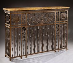Wrought iron console forming radiator cover, marble top. Circa 1925 H : 41 1/3 L : 61 D : 13 in.