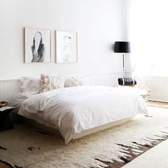 Some bedroom inspiration for the weekend! Love the personality the art work and rug bring to this space. Check out our rug collection online and in our studio for similar bespoke rugs. #thelinenyc #collectedbymolle