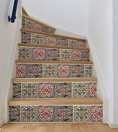 Add color to your stairs with this tile stripe. The classic color palette features indigo, deep red, and forest green. Inspired by Mediterranean tiles, the chic design gets a modern flair with peel an