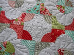 Jenny's quilting on this drunkards path is really unique and very effective.