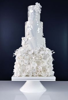 An all white wedding cake, with just a hint of dusky blue marbling and a cascade of silver leaf. Standing over 27 inches tall and decorated with over 340 sugar flowers. Fancy Wedding Cakes, Amazing Wedding Cakes, Wedding Cake Designs, Fancy Cakes, Pretty Cakes, Beautiful Cakes, Succulent Wedding Cakes, White Cakes, Cake Trends