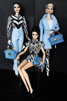 Gee we were so stunning they made dolls of us.