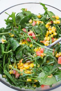Recipe for Mexican Arugula Corn Salad which includes Arugula, Spinach, Tomatoes, Corn and a Olive Oil/Lime/Cumin dressing.