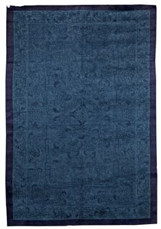 A Chinese Rug - An Early 20th Century Chinese Rug . Completely tonal rug in various shades of blue. Although intricately patterned it reads almost like ...