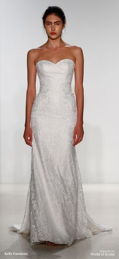 Chantilly lace strapless fit to flare gown with sculpted seaming and crystal beaded detail.