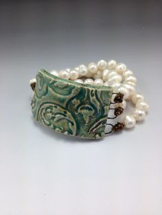"""""""Nouveau Pearl"""" Ceramic, Freshwater pearl and Brass bracelet by Madeline Henry"""