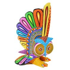 This multicolored owl was created by Magaly Fuentes. Sheis a member of the multi-talented Fuentes family. Her father is Epifanio Fuentes and her brother Zeny.